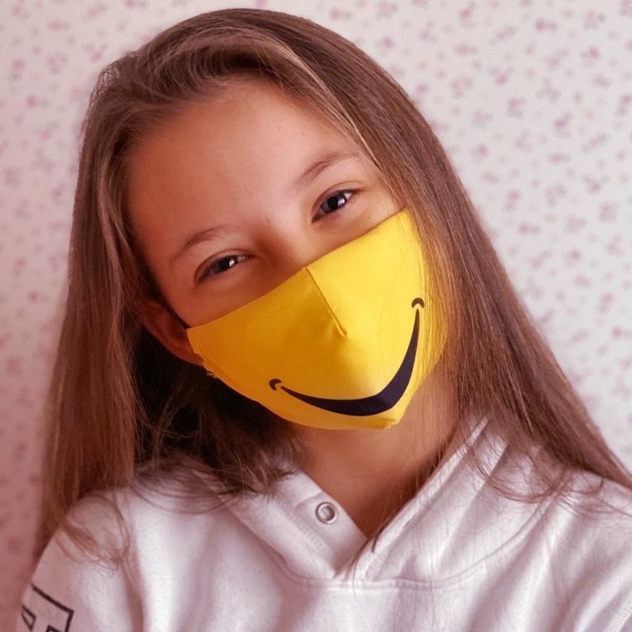 Lasten kasvomaski Facewear uudelleenkaytettava keltainen Smile